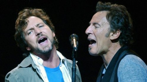 """Eddie Vedder and Bruce Springsteen during """"Vote For Change"""" Closing Night Concert - October 13, 2004 at Continental Airlines Arena in East Rutherford, New Jersey, United States. (Photo by Debra L Rothenberg/FilmMagic)"""