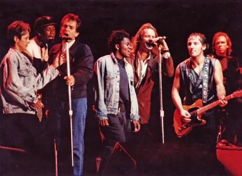Left to right: Joan Baez, Youssou N'Dour, Peter Gabriel, Tracy Chapman, Sting, Bruce, Danny Federici.